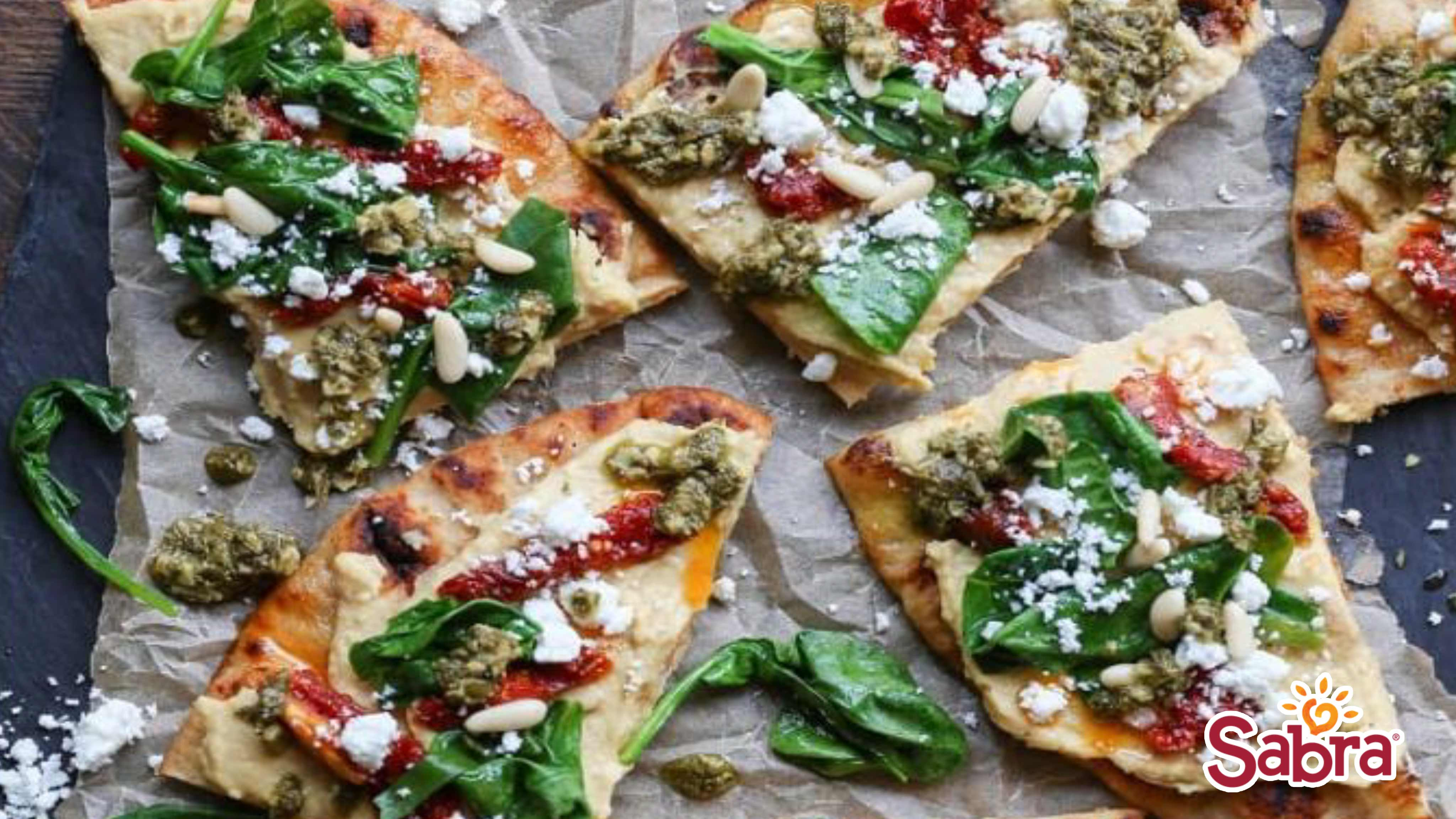 Image for Recipe Hummus Flatbread with SunDried Tomatoes, Spinach and Pesto
